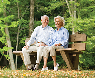 Photo of a couple sitting on a bench. Links to Gifts by Will