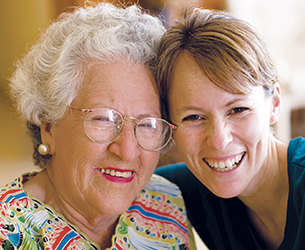 Photo of two women smiling. Links to Gifts That Protect Your Assets
